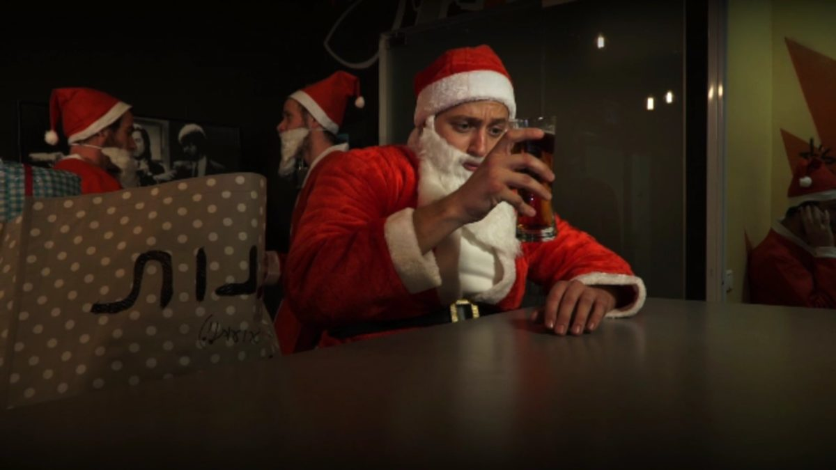 Sad santa drinks beer